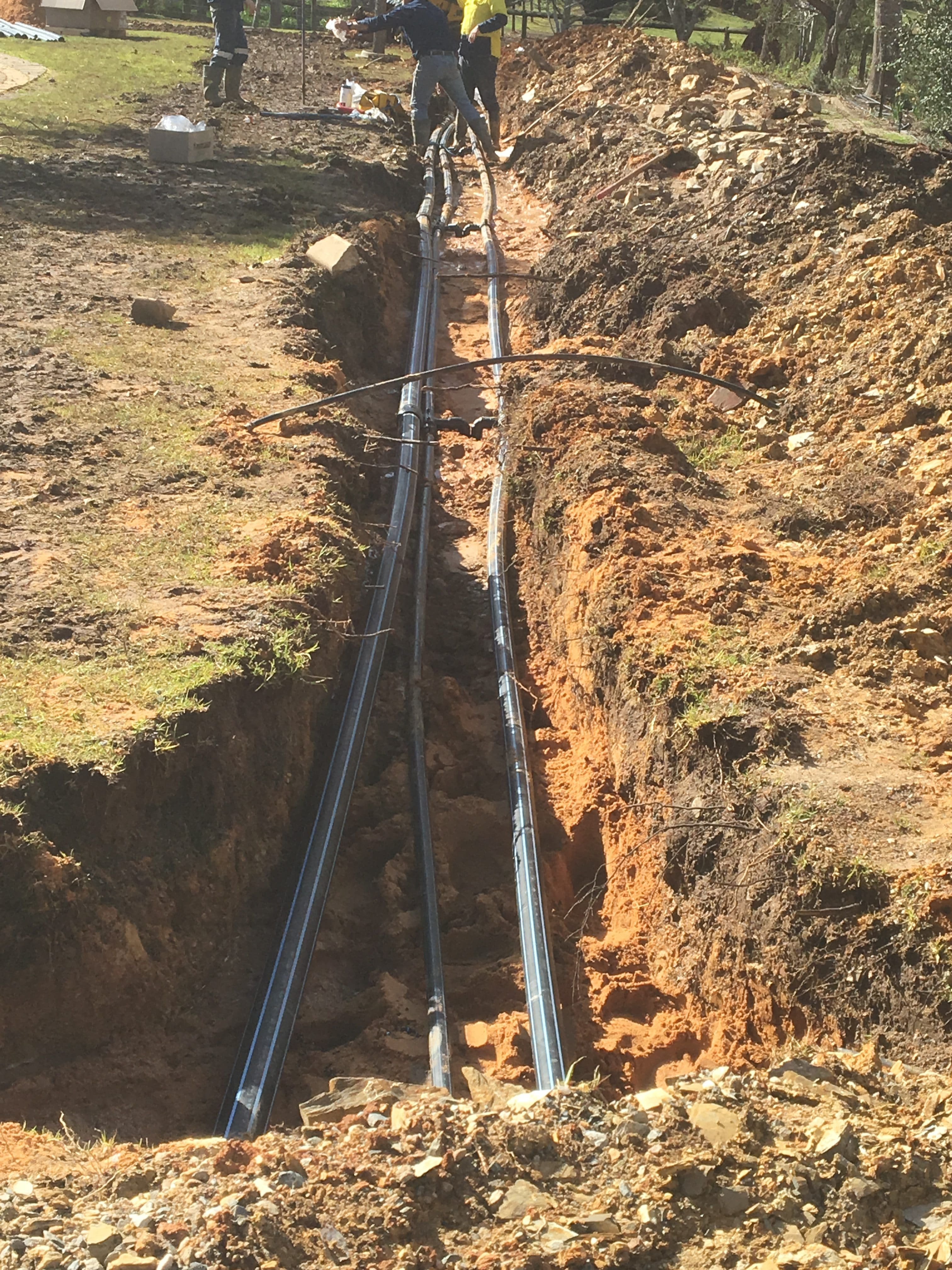 Utilising the thermal storage of the earth with geoexchange ground loops.