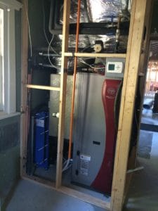Geoexchange heat pump installed using bore water in a heat exchange
