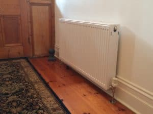 Hydronic wall mounted radiator retrofitted in a home in Adelaide