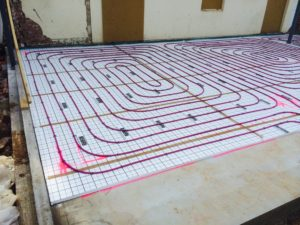 Hydronic underfloor and radiator heating with geoexchange